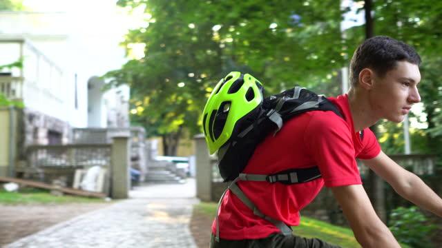enjoying ride through city park - one teenage boy only stock videos & royalty-free footage