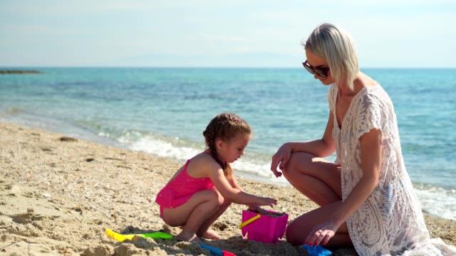 enjoying summer vacation on the beach - swimwear stock videos & royalty-free footage