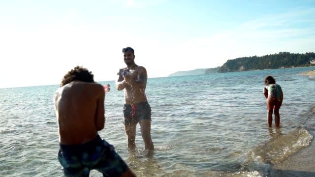 enjoying summer vacation on the beach - water pistol stock videos & royalty-free footage