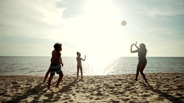 enjoying summer vacation on the beach - volleyball sport stock videos & royalty-free footage
