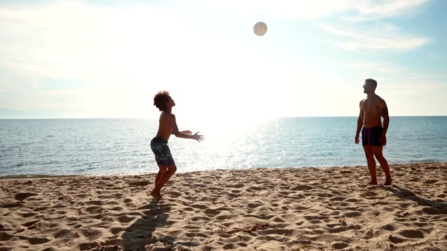 enjoying summertime with father on the beach - volleyball sport stock videos & royalty-free footage