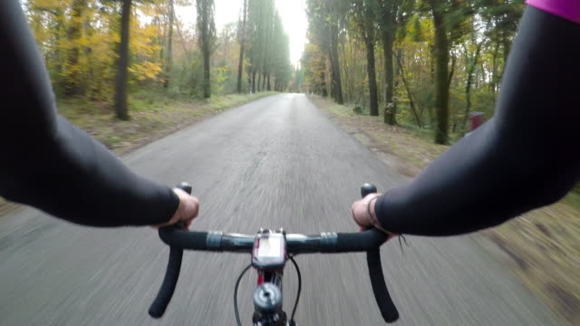 Enjoying the autumn season in Tuscany on bicycle. POV