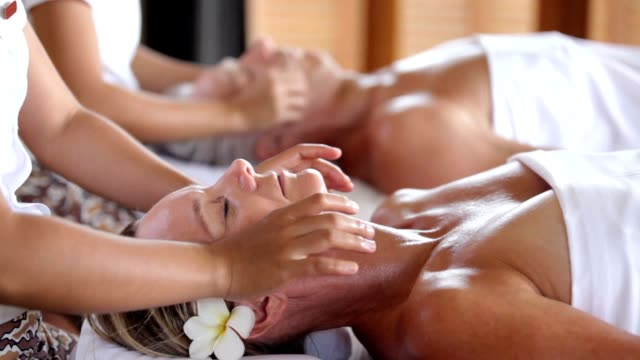 enjoying the blissful getaway they deserve - spa treatment stock videos & royalty-free footage