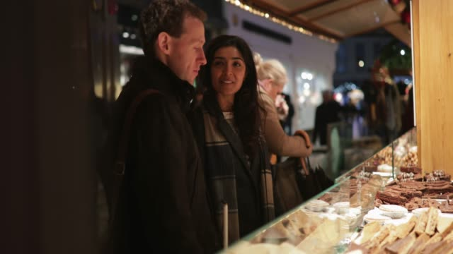 enjoying the christmas market together - blindness stock videos & royalty-free footage