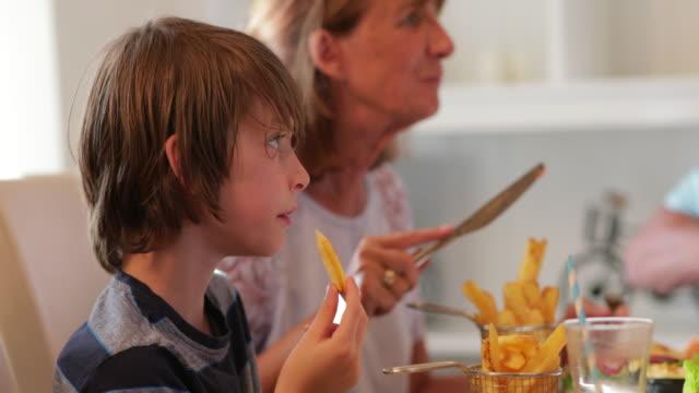 enjoying the food - multi generation family stock videos & royalty-free footage