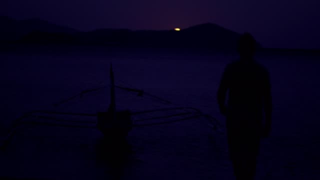 enjoying the moonlight at the beach - midnight stock videos and b-roll footage