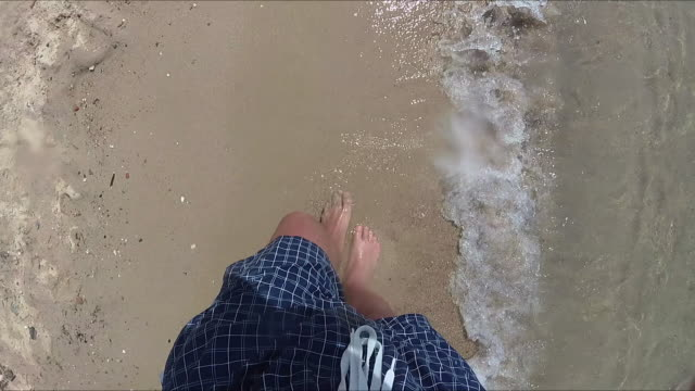 enjoying the sea / ocean. focus is on the feet. - human toe stock videos and b-roll footage