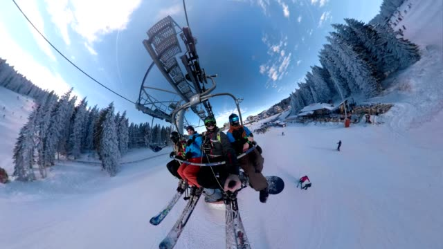 enjoying the ski lift ride - seggiovia video stock e b–roll