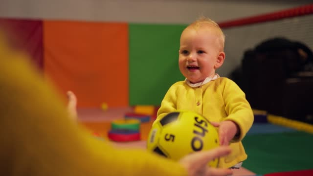 enjoying the soft play area - passing giving stock videos & royalty-free footage