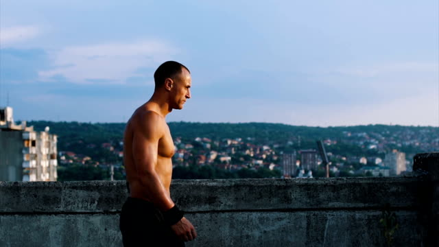 enjoying the sunset from the roof - shirtless stock videos & royalty-free footage