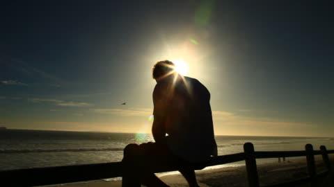 stockvideo's en b-roll-footage met enjoying the sunset - staring