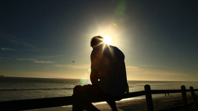 stockvideo's en b-roll-footage met enjoying the sunset - loneliness