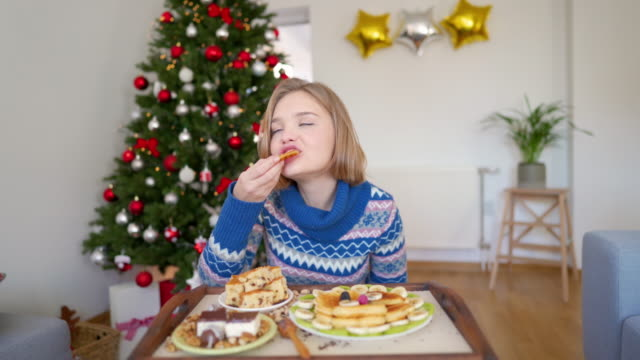 enjoying the taste of christmas - over eating stock videos & royalty-free footage