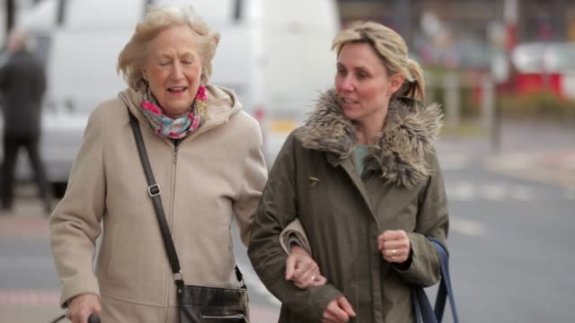 enjoying their day out shopping - healthcare worker stock videos & royalty-free footage