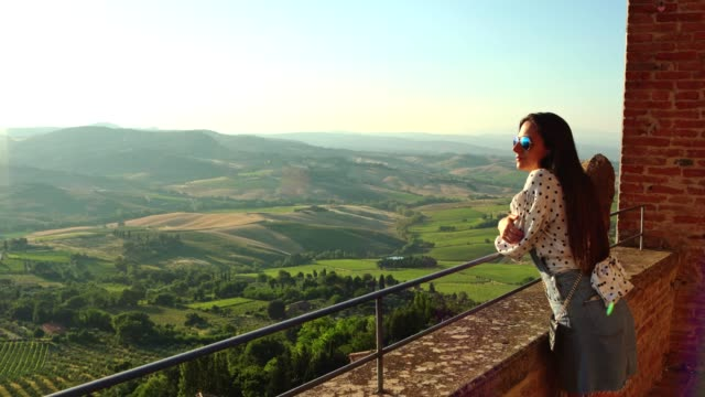 enjoying tuscany with a view - soleggiato video stock e b–roll