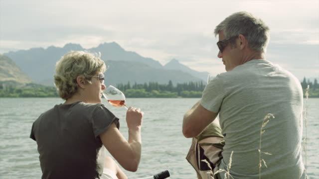 Enjoying wine by the lakeside