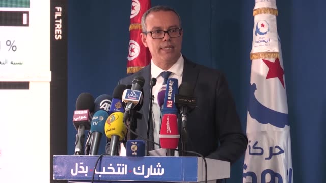 Ennahda Party spokesman Imad alKhomeini speaks to the media at party headquarters after after early result sin the local elections were announced on...