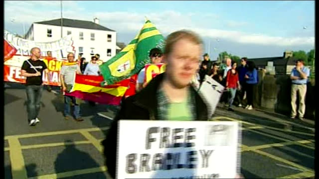 protests NORTHERN IRELAND Enniskillen EXT Various of antiglobalisation protesters along carrying placards opposed to G8 'G8 Not Welcome'/ Various of...