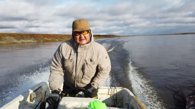 enoch adams pilots his boat during a hunt for caribou on september 10, 2019 in kivalina, alaska. the hunters in the village have seen the migration... - jet boating stock videos & royalty-free footage