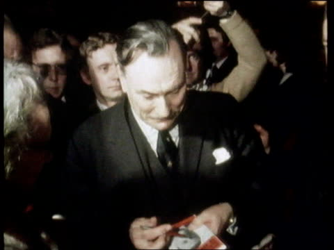 enoch powell death reactions ulm2352 ext/night powell signing autographs lib london westminster day gv houses of parliament seen across thames - enoch powell stock videos & royalty-free footage