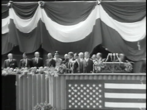 enormous crowds jam the streets of west berlin to cheer u.s. president john f. kennedy as he stands on a balcony with mayor willy brandt. - guerra fredda video stock e b–roll
