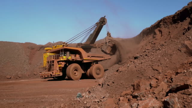 enormous shovel loads iron ore onto truck - metal ore stock videos & royalty-free footage