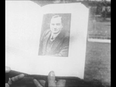 enrico caruso's wife dorothy and daughter gloria look at first copy of biography of caruso while seated in a park in new york city ny/ gloria kisses... - biography stock videos & royalty-free footage