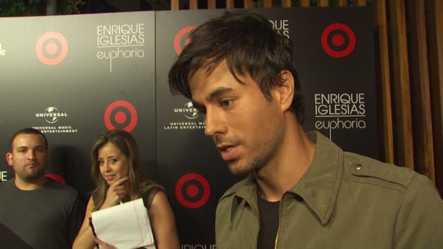 enrique iglesias on the new album how it feels to create his first bilingual album about his partnership with target and the deluxe version of... - cast member stock videos & royalty-free footage