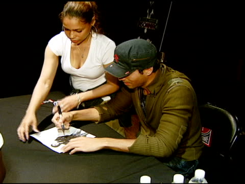 Enrique Iglesias with fans at the Enrique Iglesias Promotes Release of 'Insomniac' with Performance and Signing at Virgin Megastore in Hollywood...