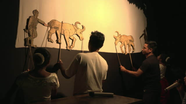 ensemble performing traditional shadow puppet play - puppet stock videos & royalty-free footage