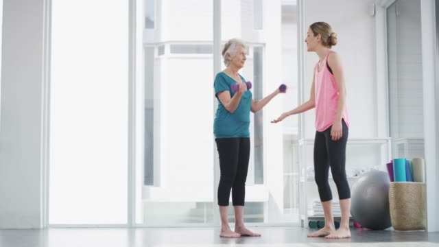 ensuring her senior years stay healthy years - exercise class stock videos & royalty-free footage