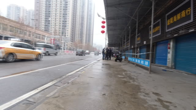 <<enter caption here>> on january 24 2020 in wuhan china - wuhan stock-videos und b-roll-filmmaterial