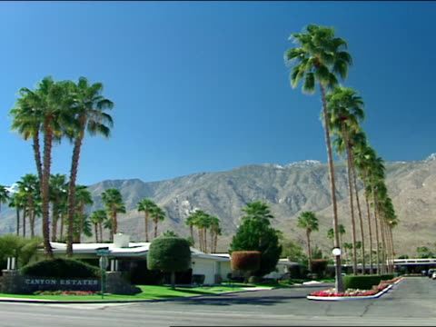 enterance to canton estates subdivision w/ mountains bg midcentury modern design - palm springs california stock videos & royalty-free footage