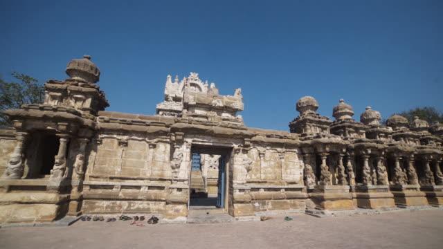 entering at hindu ancient temple kailasanathar steadicam shot - sculpture stock videos and b-roll footage