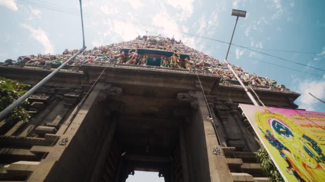 entering at the hindu temple of kapaleeswarar. dolly shot, steadicam, walking motion - chennai stock videos & royalty-free footage