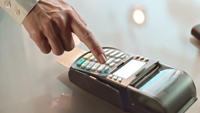 SLO MO TD entering credit card PIN and terminal printing
