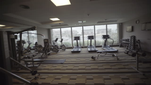 entering exercise room - exercise machine stock videos & royalty-free footage