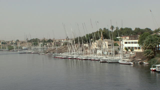 POV Entering harbor of Aswan with feluccas docked at Elephantine Island, Aswan, Egypt