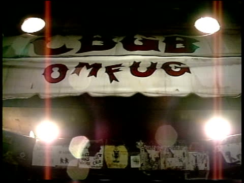 pov of entering main door at cbgbs - punk music stock videos & royalty-free footage