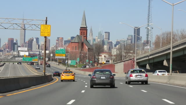 entering new york city on the long island expressway. - queens new york city stock videos & royalty-free footage