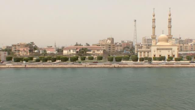 ws pov entering suez canal, city skyline, suez, egypt - suez canal stock videos & royalty-free footage