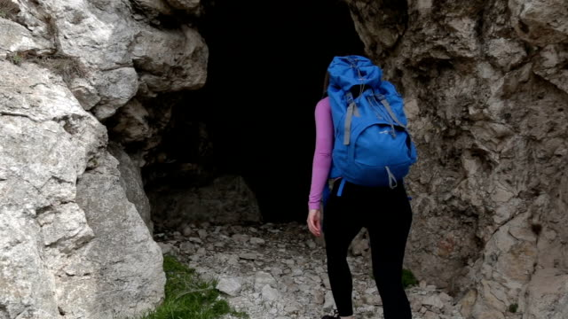 entering the mountain cave - entrance stock videos & royalty-free footage