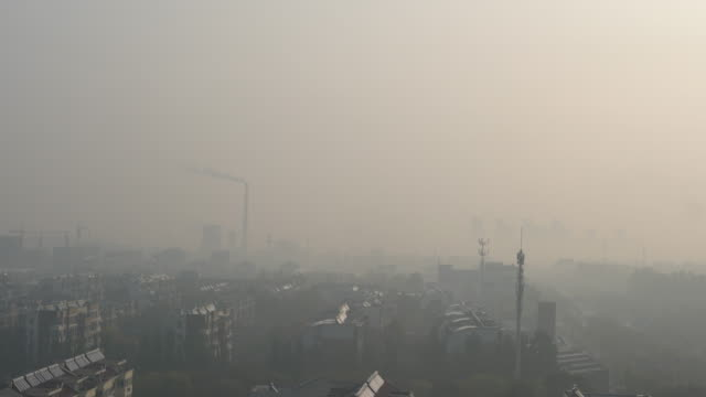 entering winter, the northern china has suffered more severe air pollution and hazy weather than last year. - luftverschmutzung stock-videos und b-roll-filmmaterial