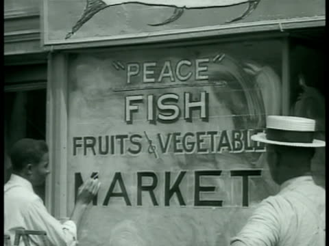 enterprises businesses in harlem authorized to use 'peace' name 'peace' fish market 'peace shine 3¢' ext building w/ 'peace' 'god' in window - god's window stock videos and b-roll footage