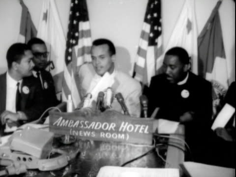 Entertainer HARRY BELAFONTE speaking at pre March on Washington press conference Ambassador Hotel Reverend Dawson the Negro American Labor Council in...