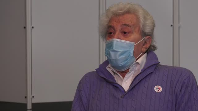 entertainer lionel blair receives the first of two injections with a dose of the pfizer/biontech covid-19 vaccine at a nhs vaccine centre that has... - lionel blair stock videos & royalty-free footage