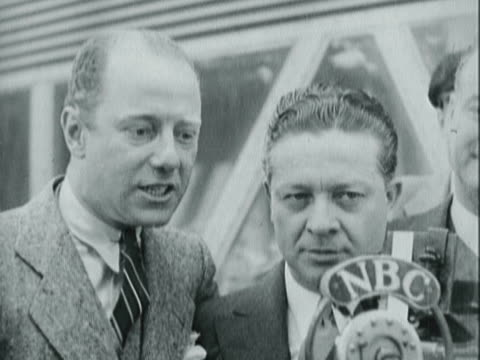 entertainers freeman gosden and charles correll doing a comedy bit in front of nbc microphone at dedication ceremony for the amos 'n' andy sky ride... - 1933 stock videos & royalty-free footage