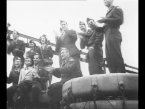 entertainers walk up gangplank, dressed in their uniforms; some wave; they travel to perform for us troops during world war ii / entertainers clap to... - performance stock videos & royalty-free footage