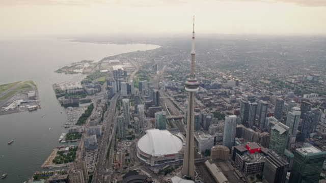 aerial entertainment district with the cn tower and rogers centre in toronto, canada - cn tower stock videos & royalty-free footage