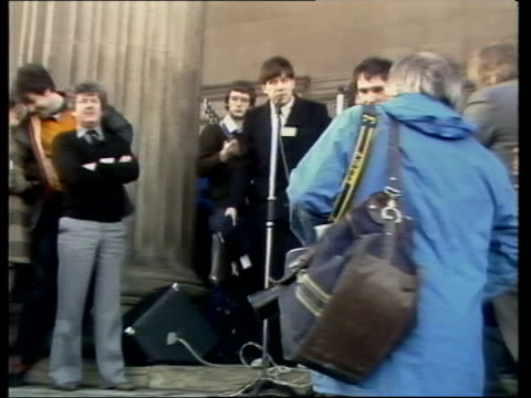 john lennon tribute england liverpool poster held pull back crowd various of crowd people address the crowd paying tribute to lennon crowd singing... - liverpool england stock videos & royalty-free footage